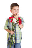 Thoughtful boy with carnations Royalty Free Stock Photography