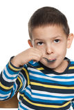 Thoughtful boy eats his breakfast Royalty Free Stock Image