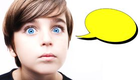 Thoughtful young boy  with an empty thought bubble Stock Photo