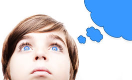 Thoughtful young boy  with an empty thought bubble. Thoughtful  boy  with an empty thought bubble Royalty Free Stock Photos