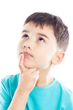 Thoughtful boy with finger on chin Stock Photos