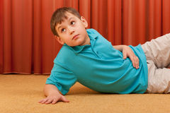 Thoughtful boy on the floor Royalty Free Stock Photo
