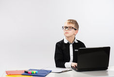 Thoughtful boy with laptop Royalty Free Stock Photos