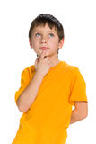 Thoughtful boy looks up Royalty Free Stock Images