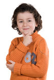 Thoughtful boy with orange clothes Royalty Free Stock Photos