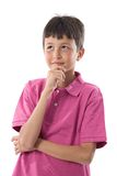 Thoughtful boy with pink clothes Stock Photography