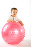 Thoughtful boy with pink fitness ball Stock Photos