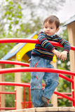 Thoughtful boy on the playground Stock Image