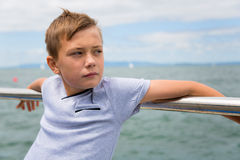 Thoughtful boy on the sea Royalty Free Stock Image