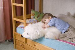 Thoughtful Boy With Soft Toy Lying On Bunk Bed Royalty Free Stock Images