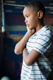 Thoughtful boy standing near window. At home Stock Photos