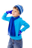 Thoughtful boy in winter clothes Royalty Free Stock Images