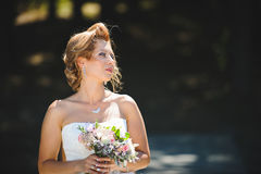 Thoughtful Bride with Bouquet. Portrait of thoughtful bride with wedding bouquet Stock Photography