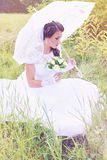 Thoughtful bride with a bouquet, vintage Royalty Free Stock Photos