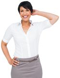 Thoughtful brown haired businesswoman in skirt Royalty Free Stock Images