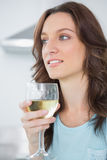 Thoughtful brunette drinking white wine Royalty Free Stock Photo