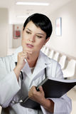 Thoughtful brunette female doctor on duty Stock Images