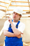 Thoughtful builder Stock Photography