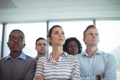 Thoughtful business colleagues standing together Stock Photography