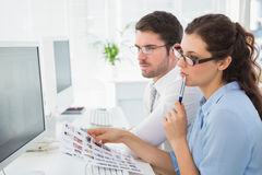 Thoughtful business coworkers working attentively Stock Photo