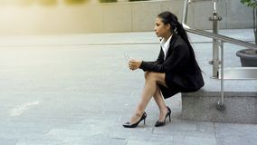 Thoughtful business lady sitting alone, female employment statistics background royalty free stock photos