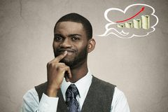Thoughtful business man corporate executive thinking how make money Royalty Free Stock Photos