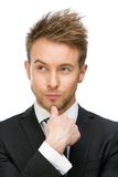 Thoughtful business man touching face Royalty Free Stock Photography