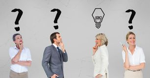 Thoughtful business people with light bulb and question marks Royalty Free Stock Photos