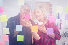 Thoughtful business team looking at a post it Royalty Free Stock Image