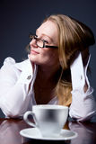 Thoughtful business woman with a cup of coffee Royalty Free Stock Photography