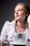 Thoughtful business woman with a cup of coffee Stock Image
