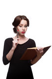 Thoughtful business woman with diary Stock Photos