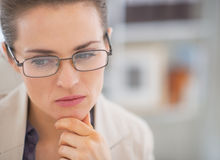 Thoughtful business woman with eyeglasses Stock Photos