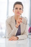 Thoughtful business woman with eyeglasses Royalty Free Stock Images