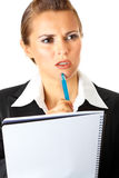 Thoughtful business woman holding notebook and pen royalty free stock photos