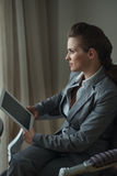 Thoughtful business woman holding tablet PC Royalty Free Stock Images