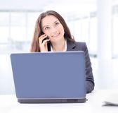 Thoughtful business woman for a laptop Royalty Free Stock Photos