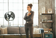 Thoughtful business woman in loft apartment Royalty Free Stock Image