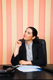 Thoughtful business woman looking away Royalty Free Stock Image