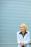 Thoughtful business woman looking at copyspace Stock Photo