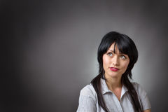 Thoughtful business woman looking up Stock Images