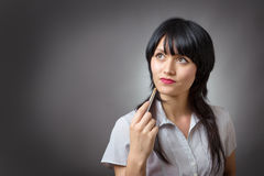 Thoughtful business woman looking up Stock Image