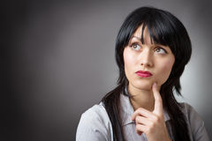 Thoughtful business woman looking up Stock Photography