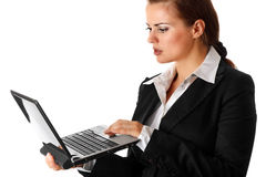 Thoughtful business woman looks in laptops screen Stock Photos