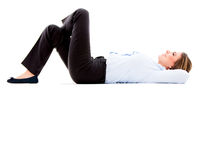 Thoughtful business woman lying down Royalty Free Stock Images