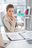 Thoughtful business woman in modern office Royalty Free Stock Image