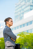 Thoughtful business woman in office district Stock Photos