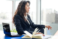 Thoughtful business woman in the office Stock Photo