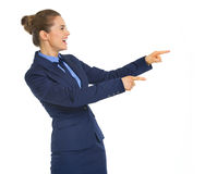 Thoughtful business woman pointing on copy space Stock Photos