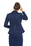 Thoughtful business woman. rear view Royalty Free Stock Photos